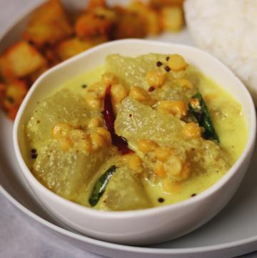 Vellai Poosanikai Kootu: White Pumpkin or Ash Gourd and Chana Dal (Split Bengal Gram) cooked in a coconut-green-chilli-cumin paste.