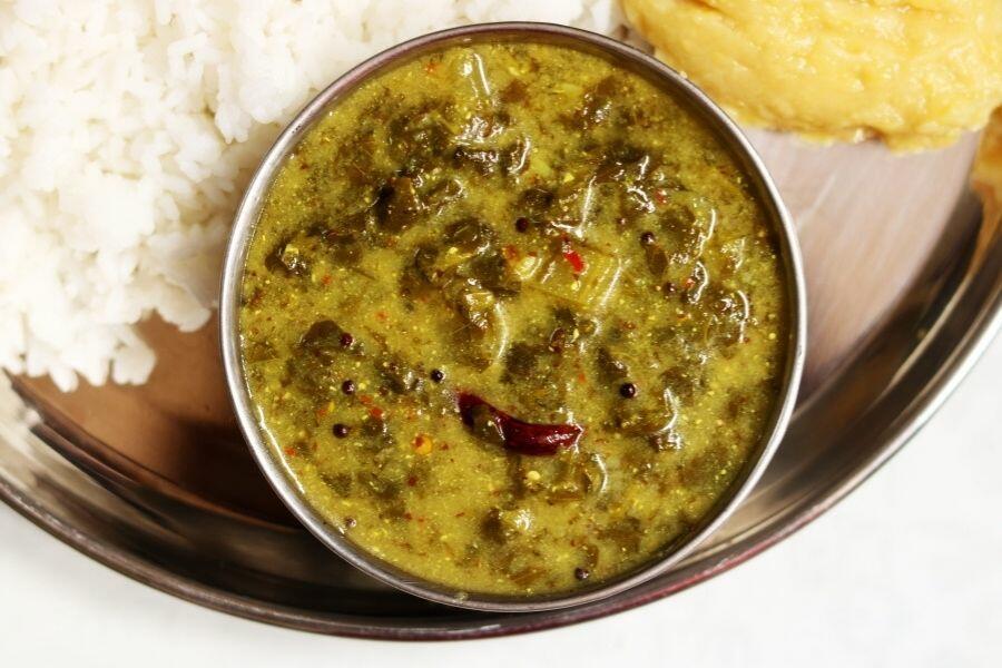 A Bowl of Ava Pettina Thotakura Pulusu with Rice and Dal