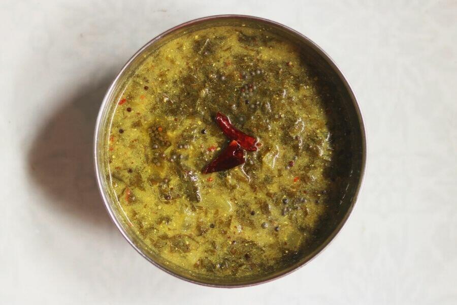 A Bowl of Ava Pettina Thotakura Pulusu from Andhra Pradesh; a gluten-free, vegan dish eaten with rice.