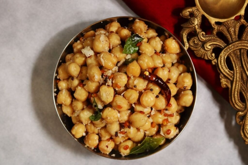 A bowl of Guggillu or Sundal, a protein-rich, vegan snack of boiled chickpeas flavoured with grated coconut.