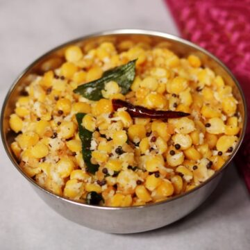 A bowl of Senaga Pappu Kobbari Kura or Kadalai Paruppu Sundal, a vegan snack rich in plant-based protein.