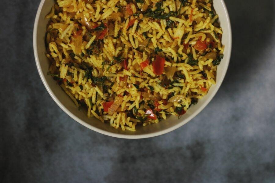 A close-up of Methi Tomato Rice | Methi Tamatar Pulao