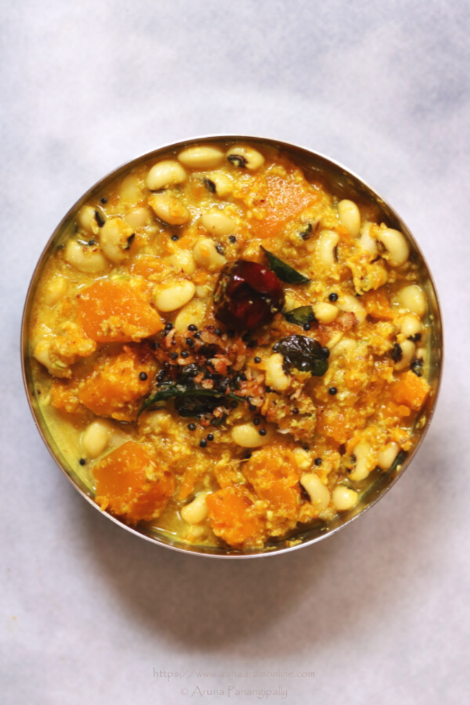 Mathanga Erissery is a traditional dish from Kerala. This Pumpkin and Black Eyed Peas in a Coconut Gravy is a part of the famous festive meals called Onam Sadya and Vishu Sadya. This is a gluten-free, vegan dish with no onion  and no garlic.
