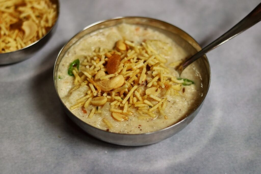 A bowl of Farali Misal or tempered boiled potato in a coconut-peanut gravy. This dish is eaten on days of fasting and is called Upvas ka Khana