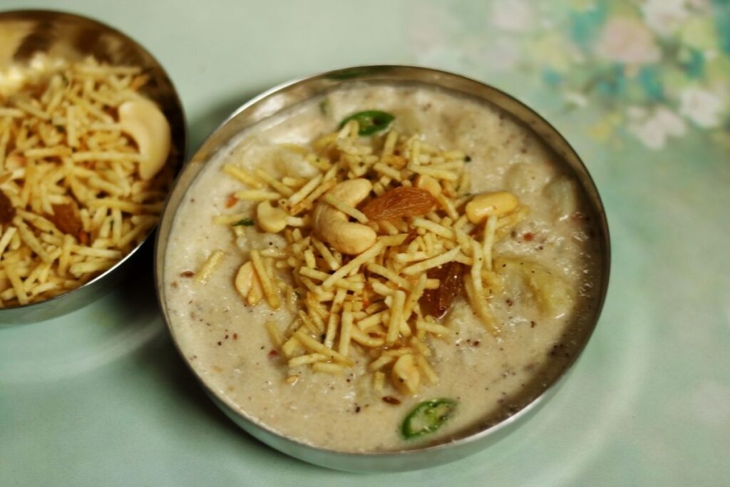 A bowl of Farali Misal with made by cooking boiled potato in a coconut-peanut gravy