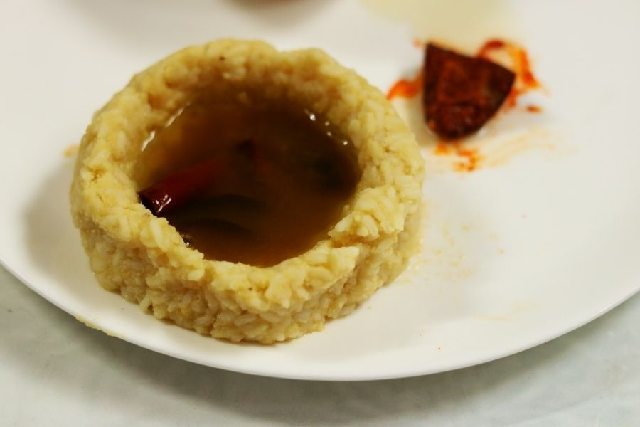 Mudda Pappu Annam, rice mixed with plain dal, served with with Charu (Andhra Rasam)