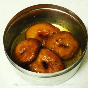 Bellam Garelu (also known as Pakam Garelu) are udad dal vadas soaked in jaggery syrup.