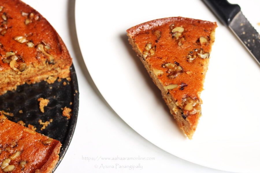 Armenian Nutmeg Cake with a biscuity base, moist cake layer, and crunchy walnut topping.