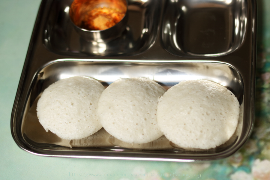 Rice and Poha Idli is a soft and fluffy steamed dumpling made with a fermented batter of rice and rice flakes (beaten rice).