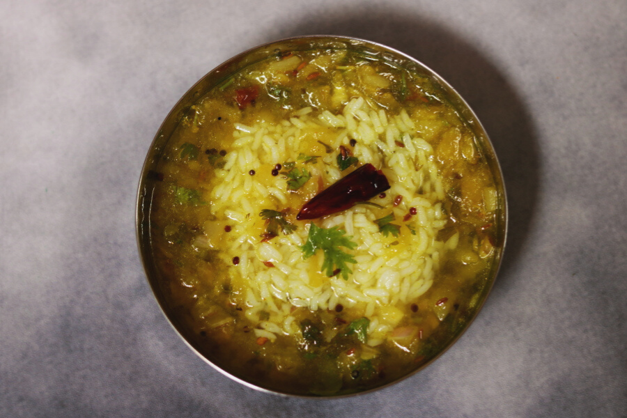 Mamidikaya Pachi Pulusu, a cold raw mango and onion rasam, with Rice