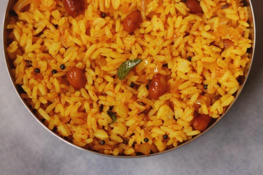 A close up of Phodnicha Bhaat, the seasoned fried rice from Maharashtra