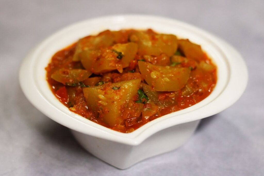 A bowl of Punjabi Tinda Masala or Tinde ki Sabzi that is very popular in North India and is served with rotis