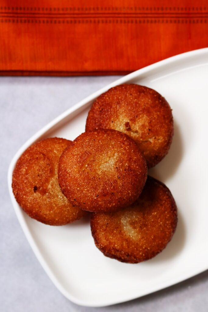Andhra Rava Appalu or Sweet Suji Appam: Deep-fried discs of semolina halwa