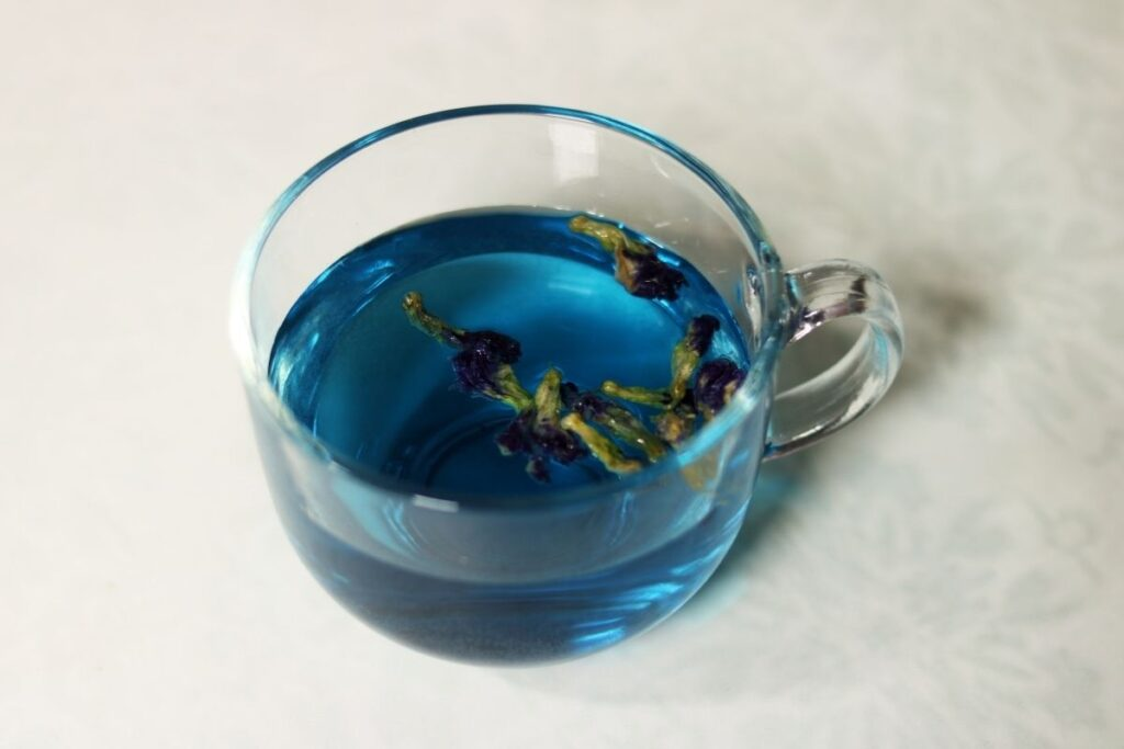 A cup of Butterfly Pea Flower Tisane, called Shankhapushpi Tea in India.