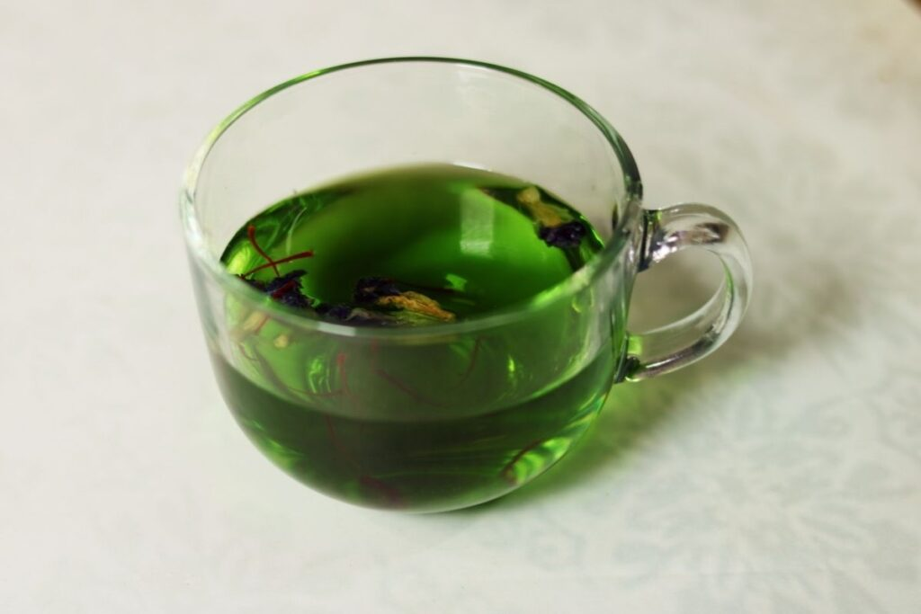 Butterfly Pea Flower Tisane or Shankhapushpi Herbal Tea turns a brilliant green when you add Saffron.