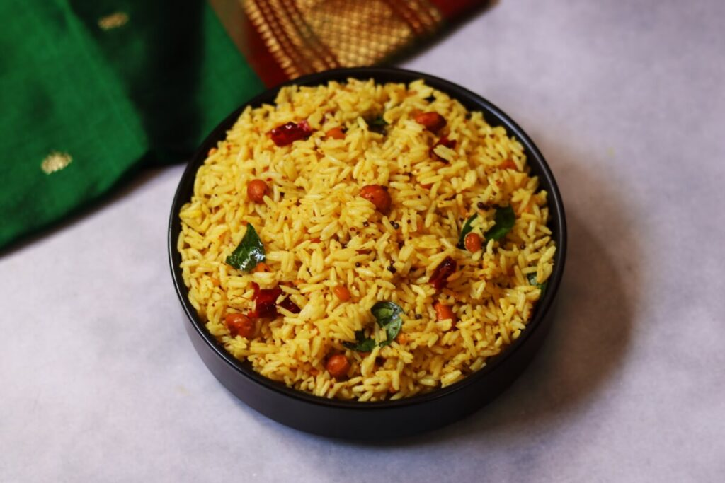 Andhra Ava Pindi Pulihora or the tamarind rice spiced up with some mustard paste