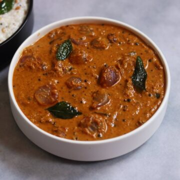 Ulli Theeyal or Shallots cooked in a Coconut and Tamarind Gravy